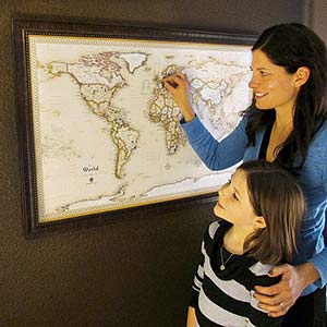 Mother and Child Exploring a Map of the World