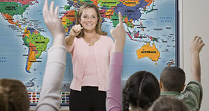 Classroom Maps Series - teacher with World Map